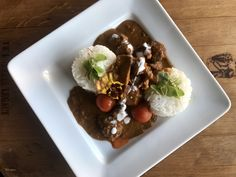 Curry 🐐Goat w/ Carrot Juice, Coconut Cream, Roasted Cherry Tomatoes, Jasmine Rice, Edible Pansy, Hearts of Fire Micro-greens