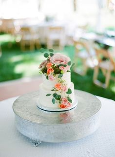 Colorful floral topped cake: http://www.stylemepretty.com/minnesota-weddings/rochester/2016/07/20/upscale-bbq-backyard-wedding/ | Photography: Laura Ivanova Photography - http://lauraivanova.com/