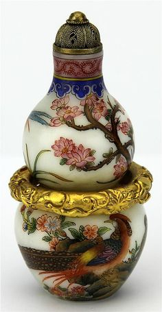 """Famille Rose Gourd Snuffe Bottle painted with pheasant and peony which symbolise to """"best for the future"""", in the mid of snuffle bottle with a gold gilt ring & Qianlong four character mark on base. Height - 8.5cm"""
