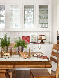 Smart! Pair loose sprigs of greenery (in sap buckets, no less) with toy deer and bottlebrush trees.