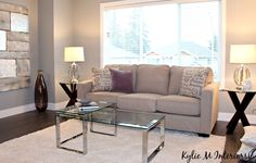 living room home staging ideas with glass, chrome, gray walls with purple undertone and dark laminate wood flooring Dark Laminate Wood Flooring, Home Staging Tips, Selling Your House, Grey Walls, First Home, Repurposed, Love Seat, Chrome, Living Room