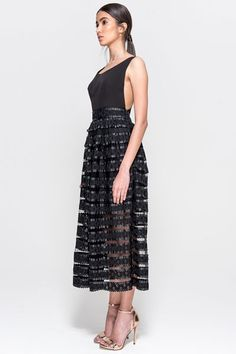 Shopping for an evening dress isn't always easy; so, when the high street just won't cut it but you're not prepared for a designer splurge, turn to our latest discovery, The 8th Sign, and its chic collection of party-ready looks. Falling somewhere between cool and feminine, their lazer-cut dresses, lace-panelled midis and ruffle-adorned playsuits come in a monochrome palette for an understated vibe — just add heels and a red lip for effortless glam.