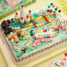 "Candy Land Birthday Cake ~ Submitter says: ""My friend asked me to make her son's 5th birthday cake, and when I asked her what he wanted on it, she said, ""Oh, just put on gobs and gobs of candy."" Instead of piling on candy haphazardly, I thought it should look like the Candy Land board game. The birthday boy, his friends and family members loved it!"" —Pen Perez, Berkeley, California"