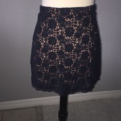 Urban outfitters crochet skirt Navy blue crochet and peach lining. In great condition, but there is a little bit of thread pretending from the side. Size 10 but fits like a medium. Urban Outfitters Skirts Mini