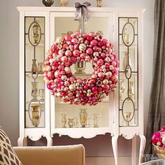 No space to hang your Christmas wreath? No worries. We love the idea of hanging this ornament-decked wreath from a display case, bookshelf, mantel, or even an interior window.