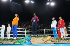 Silver medalist Nouchka Fontijn of the Netherlands, gold medalist Claressa Maria Shields of the United States and bronze medalists Dariga Shakimova of Kazakhstan and Qian Li of China pose on the podium during the medal ceremony for the Women's Boxing Middle (69-75kg) on Day 16 of the Rio 2016 Olympic Games at Riocentro - Pavilion 6 on August 21, 2016 in Rio de Janeiro, Brazil.