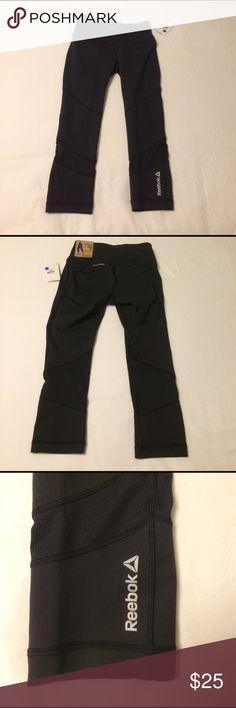 Black Reebok Yoga Pants Brand new, never worn Reebok Athletic Capri pants. Accidentally bought the wrong size. Reebok Pants Track Pants & Joggers
