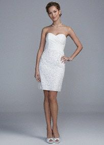 Ultra feminine and simply chic, there's no doubt that you'll look amazing on your special day!  Strapless allover lace bodice with sweetheart neckline has a flattering pleated bust.  Features scalloped lace hem line adds texture to this already exquisite dress.  Fully lined. Back zip. Imported polyester. Dry clean only.  To protect your dress, try our Non Woven Garment Bag.