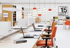 """""""Vitra's world headquarters, designed by the Bouroullec brothers, are made to adapt, with expandable suspended screens and a raised open desk system."""" I Dwell"""