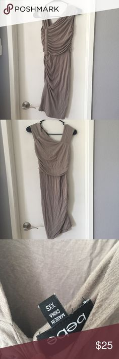 Bebe taupe tan Asymmetrical stretchy dress In perfect condition. Comes with belt to tie around waist. Size is xxs but it is super stretchy and could fit up to a medium. bebe Dresses Mini