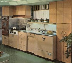 These are Youngstown Monterey cabinets -- wood door on steel cabinetry, up top. Type Youngstown Monterey into this site