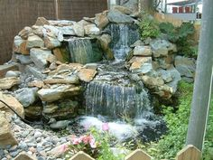 Backyard or front yard landscaping ideas that include water features create fabulous outdoor living spaces, improve curb appeal and increase home values Waterfall Landscaping, Natural Landscaping, Garden Waterfall, Pond Landscaping, Stone Water Features, Outdoor Water Features, Water Features In The Garden, Large Outdoor Fountains, Backyard Water Fountains