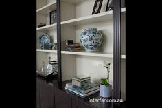 Wall Units | Interfar - Residential - Traditional black and white wall unit close up shot with traditional detailing