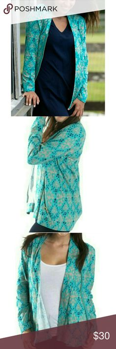 Jersey Zip Cardigan Jersey Zip Cardigan in Teal Color with Jewel Print in Navy Blue and Taupe. Features a Diagonal Zip on the Front. Made of Lightweight, Comfortable, Stretch Jersey Fabric. 96% Cotton, 4% Spandex. Fits True to Size. All For Color Sweaters Cardigans