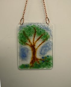 """A small fused glass Sun Catcher form Boxes By Neal.  This is one of many is my new collection of these unique, handmade pieces. They are approximately 4"""" x 6"""" and come with a copper chain for hanging in your window or on a wall."""