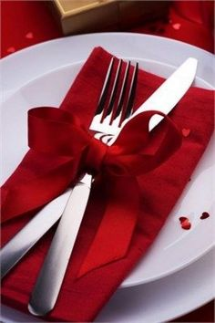 A sweet way to display cutlery on a place setting, and add that extra bit of color to your wedding reception tables. Great for Valentines or Christmas theme Christmas Table Settings, Christmas Table Decorations, Christmas Place Setting, Christmas Tables, Christmas Table Centrepieces, Red And Black Table Decorations, Christmas Table Scapes, Red Centerpieces, Red Wedding Decorations