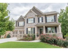 This is it!  Beautiful brick and stone front home offers hardwoods on main…