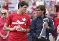 Rafael Nadal of Spain (R) and Milos Raonic of Canada hold their trophies following the men's singles finals match at the Rogers Cup tennis tournament in Montreal August 11, 2013. REUTERS/Christinne Muschi Congrats to Rafa on winning his historical 25th Master's 1000 Shield : )