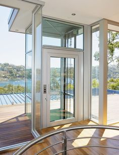 Home elevators on pinterest elevator custom homes and for Coastal house plans with elevators