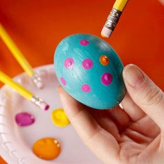 Add polka dots to an Easter egg using a pencil eraser dipped in paint.