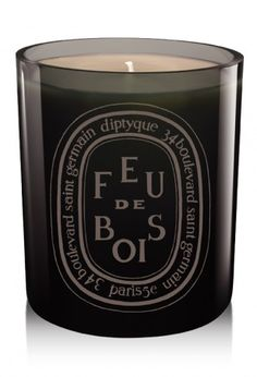 Bliss--The classic Feu de Bois scent presented in a mouth-blown glass, colored during production for a shiny finish that lets you see the candle flame. Feu de Bois recalls the warm, familiar, sophisticated accord of rare woods throughout the long winter days. Size: 300g (10.2 oz).