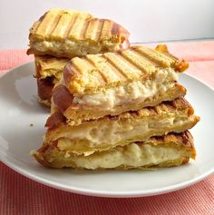 A cheesecake panini is like a grilled cheese, with cheesecake. Layer cheesecake filling on a slice of brioche or challah and heat in a panini press until warm and gooey.