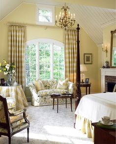 Traditional Bedroom / with Sitting Area. Very interesting as to how the drapes are hung up high over the curving top of the window.