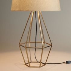 Brass Diamond Table Lamp Base. Crafted of cast iron with a warm brass finish and an open, diamond-shaped design, our mid-century-style table lamp adds a unique geometric presence to any room. Top it with any of our table lamp bases to create a personalized look.