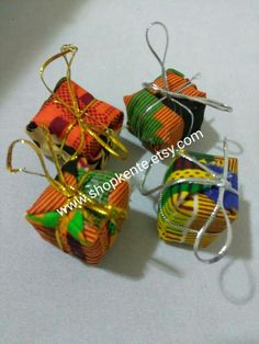 Items similar to 4 piece African gift ornaments, Holiday tree ornaments, African Kwanzaa / Kente mini gifts/Craft Supplies/ Christmas Decor/ Kwanzaa ornament on Etsy Mini Christmas Tree Decorations, Handmade Christmas Tree, Holiday Tree, Holiday Ornaments, Coastal Christmas, Black Christmas, African Christmas, Happy Kwanzaa, African Crafts