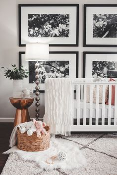 Total statement wall >> Large Black and White Floral Photos Behind Crib - Project Nursery