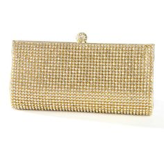 The glamorous Evening Bag with Bezel Set Crystals is ready for the red carpet!  This sparkling evening bag is made of a single cut of textured gold or silver faux leather seamlessly wrapped around a sleek frame. It is topped with a regal jeweled clasp and has two detachable chains in wrist and shoulder lengths. A must-have addition to your evening bag collection!