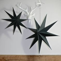 Fantastic paper starsAvailable in two sizes  These wonderful nine pointed stars fold flat for storage and simply pop open when you want to add impact and glamour to your home. These look stunning in a window at anytime of year and make a wonderful addition to a modern Scandinavian interior  Available in two sizes these can be combined together, a cluster these would create a truly striking display above your table100 % paperSmall: D 45cm Large D 60cm