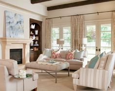 Khaki and white with a pop of color- love this relaxing living room.