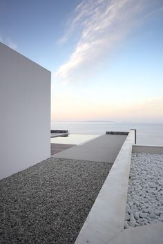 Overlooking the seaside in Greece is the elegant Villa Melana. Created by local designers Panagiotis Papassotiriou and Valia Foufa, the focal point of the home is the spectacular view of the sea and sky. Each of the main living areas was designed to take in the stunning Greek environment, and the materials used were carefully selected to incorporate the home into the natural landscape.
