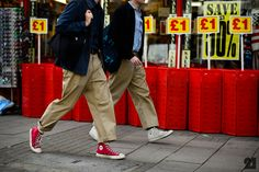 Street Style from the Men's Show In London: Two men wearing cropped khaki pants