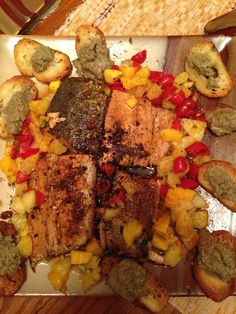 Blackened and pan seared orange/lime mahi mahi with a tropical fruit and tomato relish. Crustinis with pumpkin butter a side.