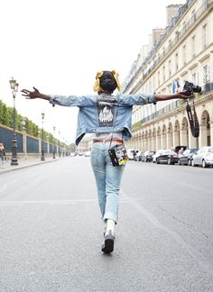 She walks the City of Light in customized Levi's and the colors of Cameroon. Meet Sandrine of the ultra-chic Parisian store Colette. See her #LiveInlevis story at www.levi.com/liveinlevis