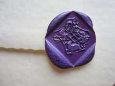 Harry Potter Hogwarts Crest PURPLE Peel Wax Seals. £1.00, via Etsy.