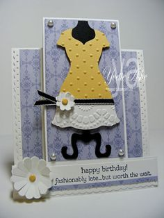 Dress Up Center Step Card--Stamps: All Dressed Up     Paper: Whisper White, Basic Black, So Saffron, Wisteria Wonder DSP     Ink: Black StazOn     Accessories: Perfect Polka Dots Embossing Folder, Delicate Designs Embossing Folder, Dress Up Framelits Dies, Big Shot, Dotted Scallop Ribbon Border Punch, Basic Black 1/8″ Taffeta Ribbon, Boho Blossoms Punch, 1-1/4″ Scallop Circle Punch, So Saffron Brads, Pearls, Stampin' Dimensionals