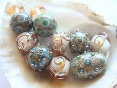 11 Handmade Lampwork Beads. $52.00, via Etsy.