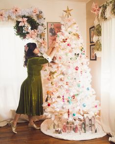 Want a pastel perfect Christmas? Look no further than for inspiration! 💗Her festive Winter White Christmas tree is filled with vintage ornaments, travel memorabilia, and a whole lot of pastel hues! White Artificial Christmas Tree, White Christmas Trees, Pink Christmas, Winter Christmas, Christmas In July Decorations, Christmas Decor, Summer Trees, Decorating Ideas, Valentine Tree