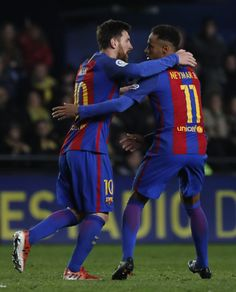 Barcelona's Argentinian forward Lionel Messi (L) celebrates with Barcelona's Brazilian forward Neymar after scoring during the Spanish league football match Villarreal CF vs FC Barcelona at El Madrigal stadium in Vila-real on January 8, 2017. / AFP / JOSE JORDAN