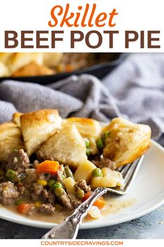 This Skillet Beef Pot Pie Recipe is the ultimate comfort food! It's filled with ground beef and vegetables in an easy to make homemade gravy. Top with homemade or store bought biscuits for a meal that will please the whole family! #skilletpotpie #beefpotpie