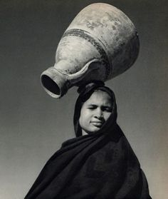 Fellahin woman with empty water vase