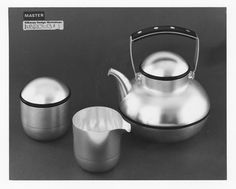 Handmade Tea service designed by James Kirkwood. Satin finished Silver teapot with acrylic fittings and matching creamer and covered Sugar bowl. 1970-08 Teapot: Height 18cms, Weight 559grms Sugar Bowl: Height 9cms, Weight 225grms Creamer: Height 8cms, Weight 2150grms Kilkenny Design Workshops  Created as a speculative piece,  handmade & sold as people commissioned the set.