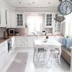 charming cottage eat-in kitchen with table in the middle and window seat-although I'd prefer a couch