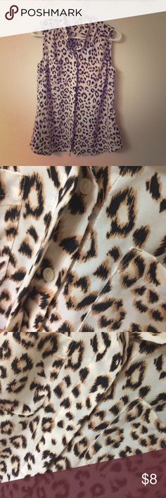 Leopard Print Top Dalia Collection leopard print top. Great condition! Only worn a couple of times! 100% Polyester. Two breast pockets. Button-down front with panel to hide buttons for a classy look. Dalia Collection Tops Button Down Shirts