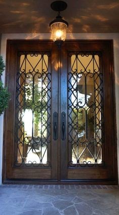 Candy likes these doors. The Puerta Albanico is a pair of Spanish entry doors featuring hand-forged iron scrollwork placed over glass panels. Spanish House, Spanish Style, Spanish Colonial, Door Design, House Design, Exterior Design, Hacienda Style, Iron Doors, Iron Front Door