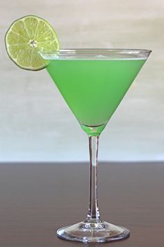 Emerald Rain cocktail drink recipe with Hpnotiq, vodka, orange and lime. http://mixthatdrink.com/emerald-rain/