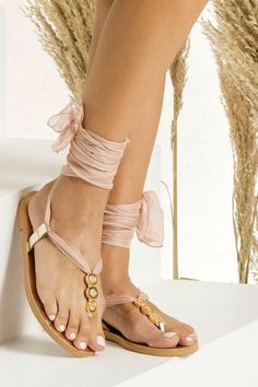 Fully Customizable Gladiator Sandals: Choose scarf laces from 15 colors, leather footbed from 6 colors and silver or 24k gold plated embellishments! Our Sophia IV sandals are handmade of gold leather in Athens, Greece using traditional techniques. These unique flats fasten securely with wraparound silk laces in blush color and they are adorned with gold plated embellishments. Let this elegant pair ground your boho inspired dress and feel comfy yet effortlessly chic.